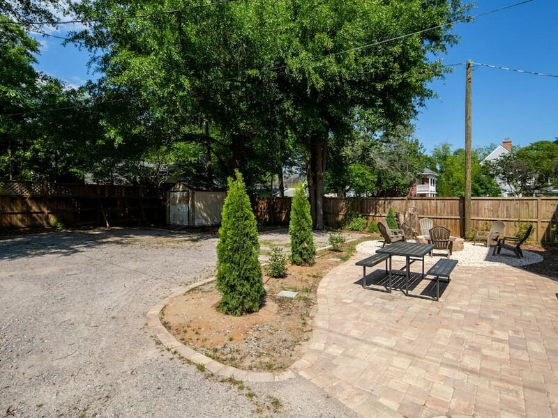 The back yard has parking for 2 vehicles, a brick paved patio, picnic area and fire pit.