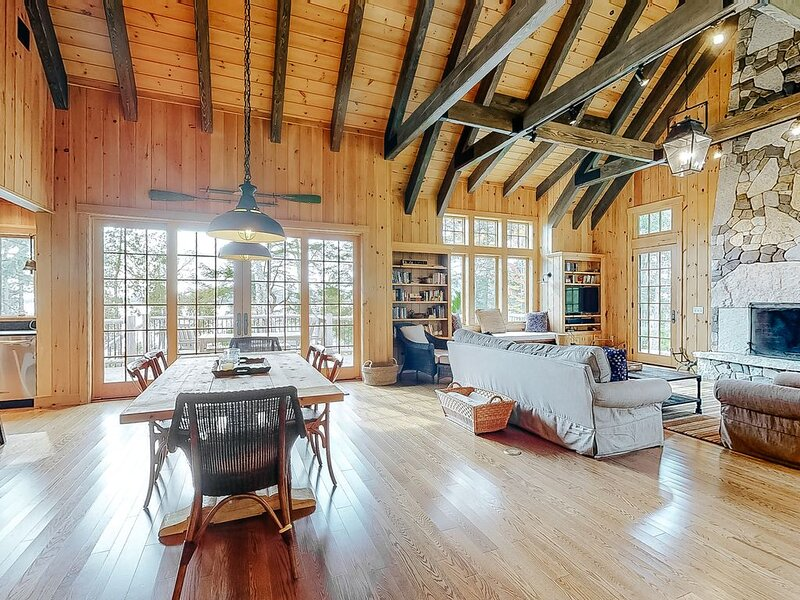 Modern lakefront lodge w/ a firepit, wood-burning fireplace, & water views!, holiday rental in Greenville