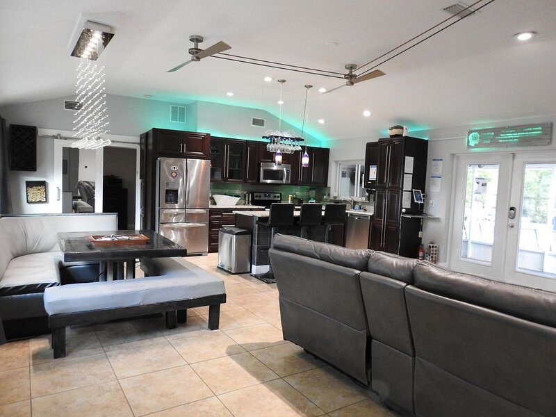 Great room and kitchen as you walk through the front door