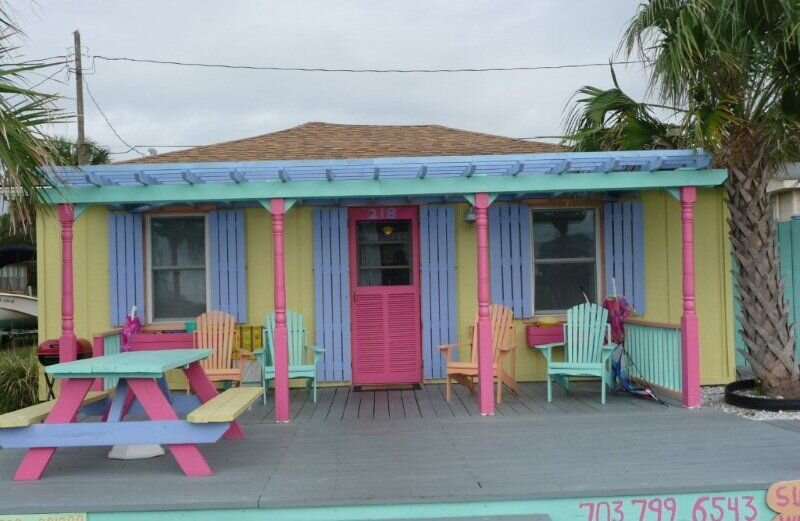 Cute and colorful cottage with large deck and outdoor shower (right).