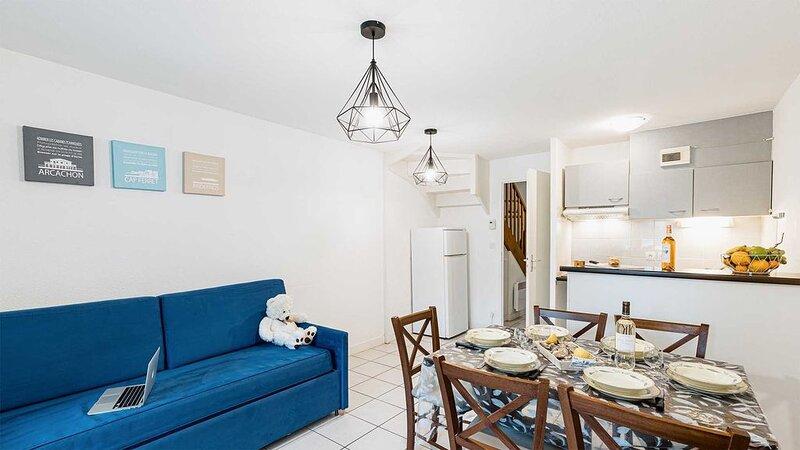 Appartement en duplex cosy et rustique | Emplacement parfait!, aluguéis de temporada em Le Teich