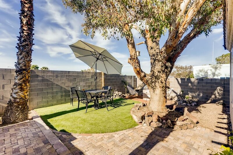 The outdoor space in the backyard  with a sitting area,