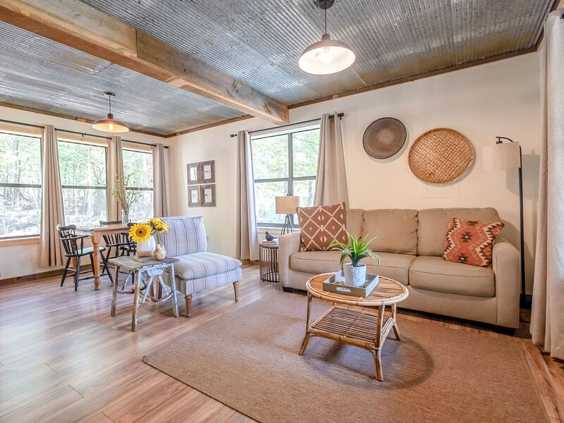 The cabin has an open concept kitchen, living, and dining area