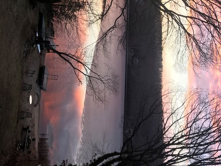 Winter Sunset on 1/2 frozen lake