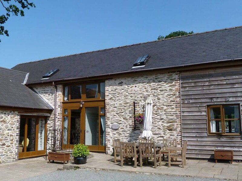 Lovely barn conversion combining modern comforts with character features such as, vacation rental in Llanwrtyd Wells