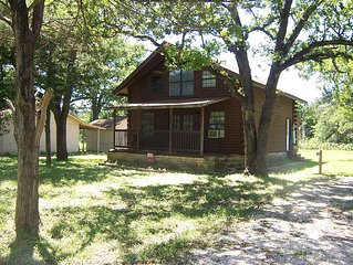 Two Story Log Cabin Located Approx 20 Miles From Austin & 15 Miles From Cota.