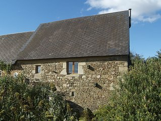 Relax in the beautiful Normandy countryside in an ancient converted barn.