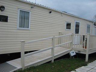 Fully accessible wheelchair adapted mobile home on site with level acces