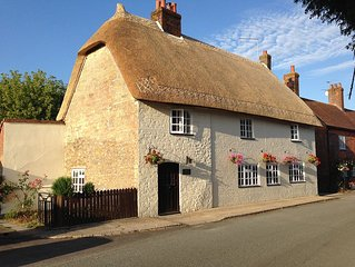 A Unique And Characterful 17th Century Thatched Cottage.