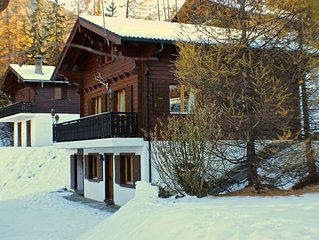 Charming Traditional Swiss Chalet with Terrace, Sauna, Log Fire, Parking