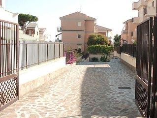 Appartamento con giardino terrazzato vicino al mare
