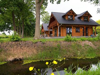 Luxury wooden villa Tine in wooded area with beautiful views over the fields.