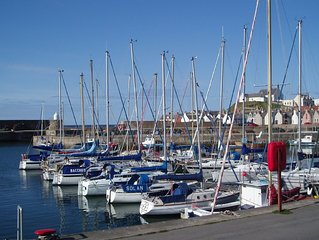 Cosy, comfortable cottage, adjacent to harbour, with stunning view over marina