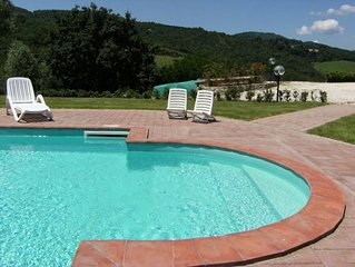 Apartment in Tuscan farmhouse in the Chianti with pool and garden near golf