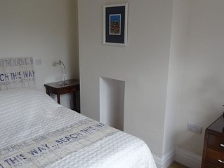 Alpha Cottage - sleeps 4. Walk to the beach. Free WIFI. Close to all amenities.