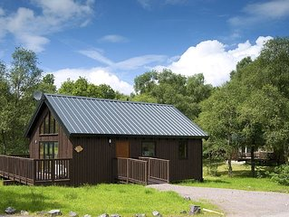 BRACKEN is a beautiful log cabin with lovely outlook over open meadow.