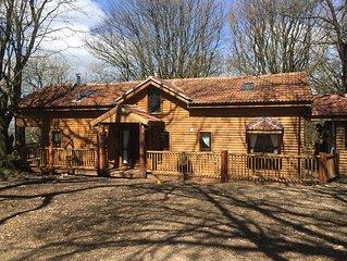 Mockham Down Grand Lodge Log Cabin With Hot Tub