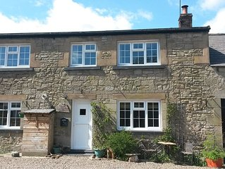 'The Stables'. A lovely stone built cottage in the small village of Powburn.