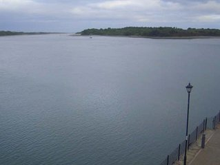 Stunning three bedroom, second floor apartment with breathtaking waterfront view