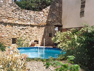VILLAGE HOUSE WITH HEATED POOL IN TRANQUIL COURTYARD