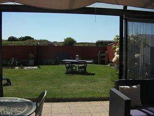 appartement 70 m2 rdc avec jardin, veranda au bord de mer, 3 personnes