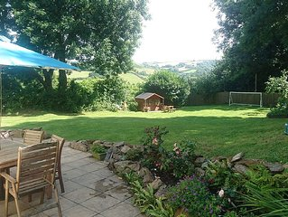 Family holiday home with fabulous garden and incredible sea & countryside views