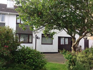 Spacious family home in centre of village close to beaches, dog friendly.