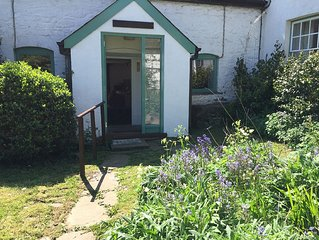 Just 10 minutes by car from Abergavenny but a rural haven on an organic farm.