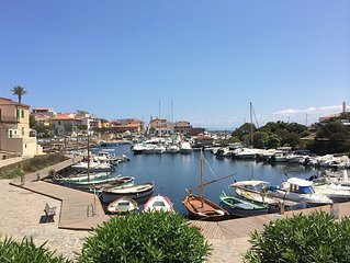In the heart of the lovely fishermen's village, right by the Porto Vecchio