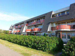 Ameland - apartment with south-facing balcony with views of meadows and the vil