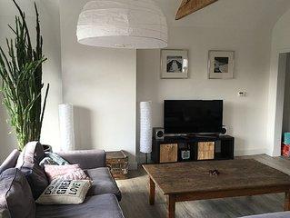 Sonnige Obergeschoss Wohnung mit großer Privater Terasse