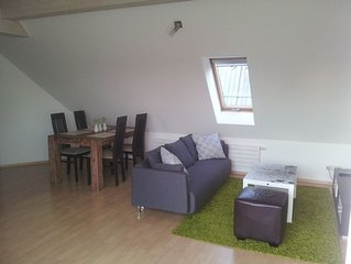 3 bedroom top floor apartment centrally with roof terrace and parking