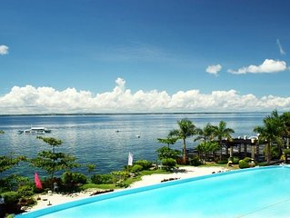 Mactan Beach Resort, 1 bedrm ,1 bath ,60sq mtr Condo w/ Ocean Views ! 4 pools