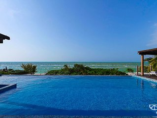 Modern beachfront 4BR condo with million-dollar views.