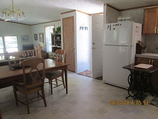 Beautiful and clean mobile home.Enjoy beautiful Torch Lake, boating,  fishing,xx