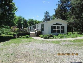 Beautiful and clean mobile home.Enjoy beautiful Torch Lake, boating,  fishing,xx