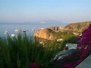 Monolocale panoramico con giardino privato vicino alla spiaggia