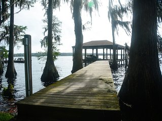 Secluded lake front home with dock on Lake Louisa only 22 miles from Disney!