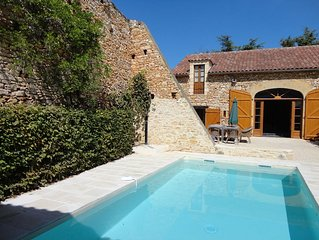 Characteristic farmhouse with swimming pool surrounded by vineyards of Cahors