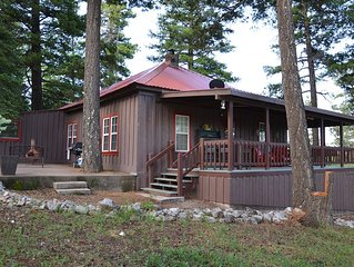 Cozy 3 bedroom 2 bath historic Cabin Retreat perfect location!