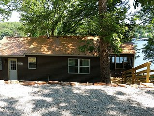 Spring  is  in the  air . Come visit  our cabin  at lake of the  ozarks .