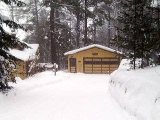 Charming 3 Bedroom Lake Cabin with large yard . Snowmobile to the State Trails.