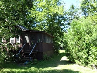 Lakefront Cottage on deep, clean Embden Pond with sandy beach access.