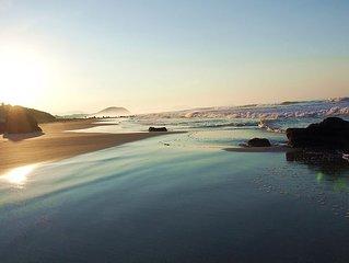 Beautiful, new beachfront villa-saltwater pool, gardens, directly on the ocean!