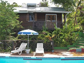 Comfortable Cottages Set In Tropical Gardens