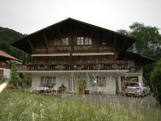 Pristine home in a charming village, large grassy sunbathing area, view of the M