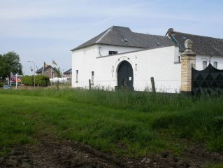 Authentic farmhouse in hilly landscape in the province of Limburg.