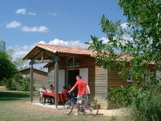Detached chalet in a holiday park with wellness centre and swimming pool, on th