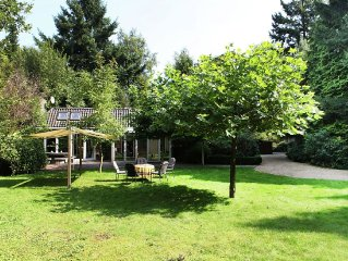 Comfortable holiday home located in a large garden with trees