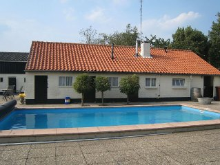 An attractive holiday home with a swimming pool in a beautiful nature reserve.